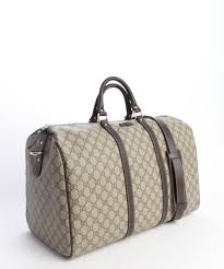 gucci duffle bag. gucci beige and cocoa gg coated canvas carryon duffel bag in cabin luggage duffle