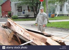 Sgt. Wesley Black surveys damage of a house in Pittsfield, Vt., while Stock  Photo - Alamy