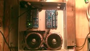 24vdc to 24vac this is a pic of the power distribution box at the present time i am only using the left side transformer and fuse block