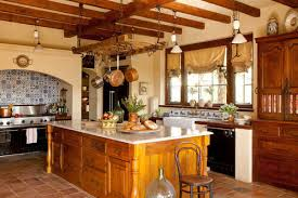 This Mediterranean style kitchen has a lovely tile mosaic backdrop to its  stove area. A