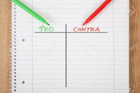 A Notepad With A Pros And Cons Chart