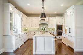 fabulous traditional white kitchen kitchen features green ceramic subway tile with green herringbone tile paired shaker cabinets with green tile backsplash