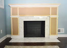 Our $200 Fireplace Makeover (Marble Tile & A New Mantel) | Young ...