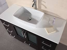 white composite stone top with porcelain vessel sink