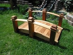 small garden bridges to sweeten your garden green lawn with simple unpolished wooden bridge