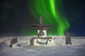 Northern Lights Stone Alaska A Traditional Stone Inukshuk With Shimmering Green Aurora