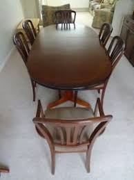 extending oval dining table with 6 chairs made by william lawrence
