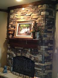faux stone fireplace eclectic