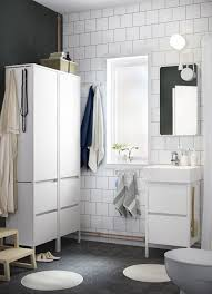 bathroom furniture ideas. A White Small Bathroom With Two High Cabinets Mirror And Wash Furniture Ideas O