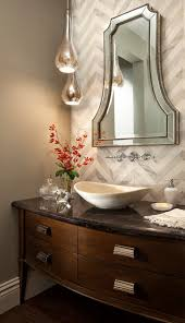 curvy pendants like the uttermost sardinia would be a great addition to your powder room lighting
