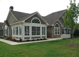 one story house with tall entrance   attached garage are all characteristics  of unique ranch homes