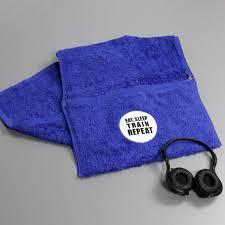eat sleep train repeat zipped pocket gym towel