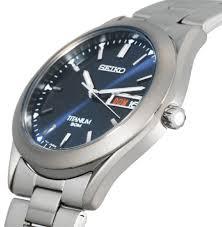 this men s titanium watch has a blue dial silver markers this men s titanium watch has a blue dial silver markers except the date at 3