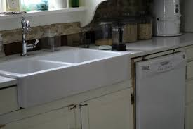 after a little trim paint and a whole lot of fananglin we had our new sink lookin pretty