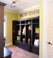 track lighting on wall. Gothic Black Mudroom Cabinet With Hidden Storages Plus Mini Track Lighting Also Yellow Wall Paint Color On