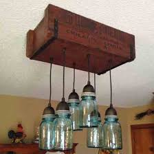 Repurpose glass jars into a pendant light fixture.