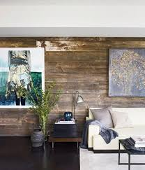 shabby chic living room with rustic wood paneled wall image source elle decor