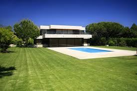designs homes. white modern home with dark windows on large grass lot in-ground swimming pool designs homes