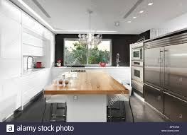 Black And White Kitchen Table Black And White Kitchen With Wooden Dining Table In Modern Villa