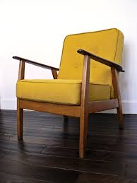 armchair with wooden frame and box cushions re upholstered in mustard linen phil shakespeare furniture for living area
