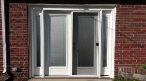 Patio Door with Mini-blinds and sidelites to convert a garage door opening