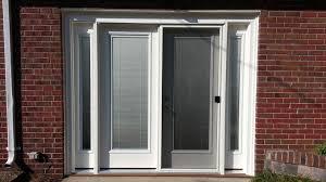 patio door with mini blinds and sidelites to convert a garage door opening