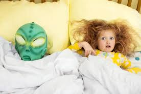 sleeping next to creepy mask