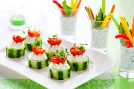 finger food with vegetables. christmas appetizers ideas cucumbers cherry  tomatoes cream cheese