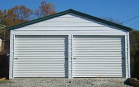 white steel building with end doors with enough area to park two vehicles plus storage area