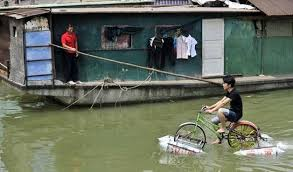 Chinese Man Designs Amphibious Bike That Runs On Water Pictures