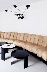tufted furniture trend. Wonderful Trend Living Room With A Neutral Tufted Sofa And Modern Black Wall Sconce To Tufted Furniture Trend K