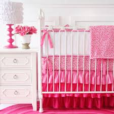 simple baby bedroom with white nightstand table with three drawers and caden lane girly pink leopard