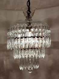 this one light wedding cake chandelier descends in a chain to a loop finial set inside a cut crystal bowl