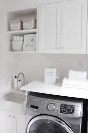 white-laundry-room-with-grey-washer-and-dryer JShomedesign via ...
