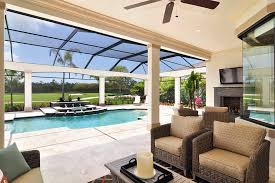 indoor pool enclosure patio traditional with outdoor stone fireplace covered pool
