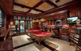billiards room with red surfaced luxury pool table