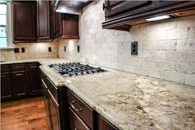 white textured granite countertop with dark colored cabinet using nice handles for traditional kitchen ideas