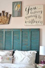 ... Beautiful turquoise shutters repurposed as a headboard