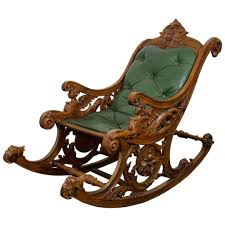a 19th century carved italian rocking chair wgriffins and rams antique wooden c 1