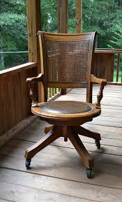 vintage office chair. vintage wood oak office chair swivel wheels cane by panchosporch 12500