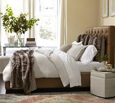 gorgeous faux fur throw in bedroom contemporary with bed headboard designs next to leather headboard alongside fur throw and black bedding