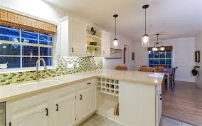 updated with pendant lights quartz countertops and finished off with beadboard trim and shiplap