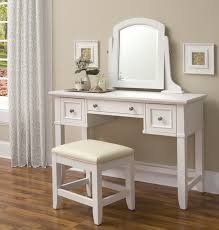 cool white makeup vanity table with single mirror and three drawer storage feat bench on wooden floor as decorate modern women bedroom designs furniture