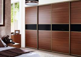 adorable desaign for large sliding closet doors with wooden material and black accent
