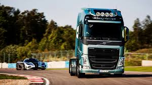 volvo truck and car 2048x1152 resolution