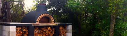 outdoor wood fired oven on brick platform with side tables