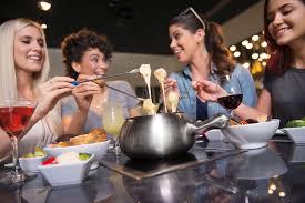 friends enjoying fondue at the melting pot
