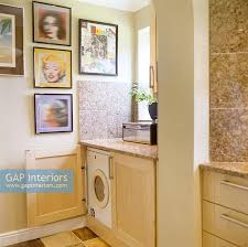 washing machine in kitchen cupboard