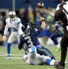 thomas rawls breaks through sets a seahawks playoff record for seahawks quarterback russell wilson throws for an incomplete pass while be tackled by the detroit lions