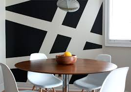 contemporary dining room interior design with chic striped wall ideas and round wooden coffee table